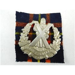 THE QUEENS OWN CAMERON HIGHLANDERS OF CANADA CAP BADGE