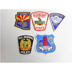 ASSORTED POLICE BADGES