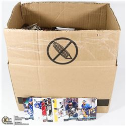 BOX CONTAINING THOUSANDS OF VARIOUS HOCKEY CARDS.