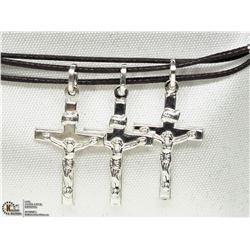 33) THREE STERLING SILVER JESUS ON CROSS PENDANTS