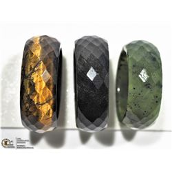 5) LOT OF 3 JADE, ONYX AND TIGERS EYE RINGS