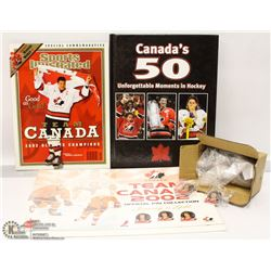 FLAT WITH TEAM CANADA PIN SET AND BOOK.
