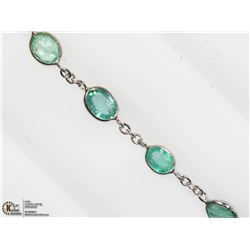 27) 10K WHITE GOLD EMERALD BRACELET