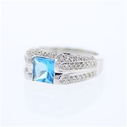 18KT White Gold 2.01ct Blue Topaz and Diamond Ring