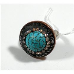 Silver and brass ring set with central turquoise gemstone