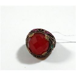Silver and brass ring set with central red-pink gemstone