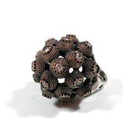 Ball-shaped silver and brass ring
