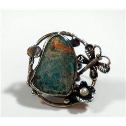 Silver and brass ring embellished with a butterfly and a large turquoise