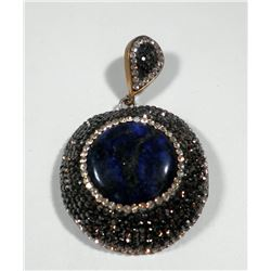 Big round silver and brass pendant set with central lapis setting
