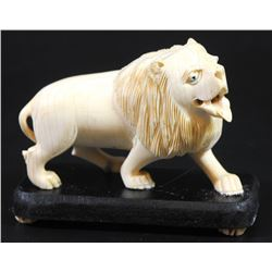 Roaring lion, old European ivory carving