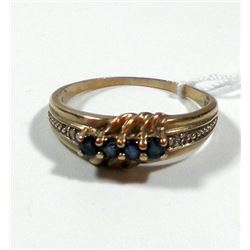 K8 gold ring set with 4 blue facetes stones