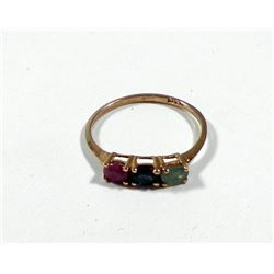K9 gold ring set with ruby, sapphire and emerald