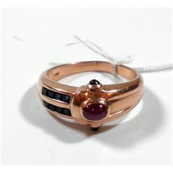 K14 gold ring set with sapphires and a ruby