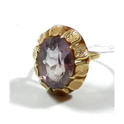 K14 gold ring with a faceted purple gemstone setting