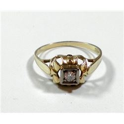 K14 gold ring set with an old faceted central diamond