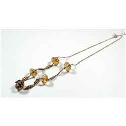 K9 gold necklace combining faceted citrine gemstones