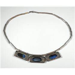 Sterling silver link necklace and part of a pendant set with metalic-color glass