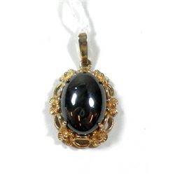 Oval K8 gold pendant with hematite setting