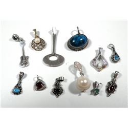 Collection of 12 silver pendants
