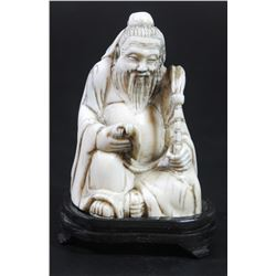 Chinese man reading a scroll - antique ivory figurine