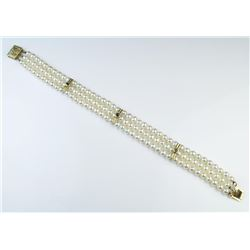 18CAI-13 PEARL BRACELETExtra Fine Pearl bracelet featuring three  rows of round cultured Pearls aver