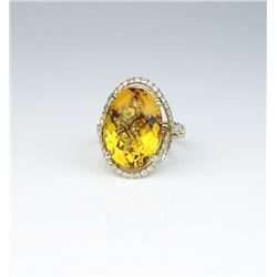 18CAI-14 CITRINE RINGGorgeous ring featuring an oval Citrine  weighing approx. 20.00 carats and micr