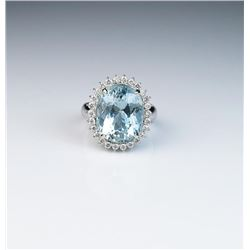 18CAI-5 AQUAMARINE & DIAMOND RINGCaptivating Princess Diana style ring  featuring an oval blue Aquam
