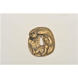 18CF-11 TSUBA BRASSFine and ornate Tsuba (Japanese sword guard)  brass alloy in ornate scene of man,