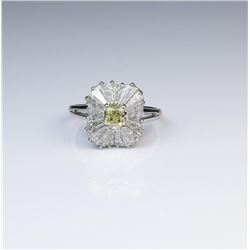 18CAI-3 YELLOW DIAMOND RINGExquisite Platinum Ballerina style ring  featuring a Natural Fancy Yellow