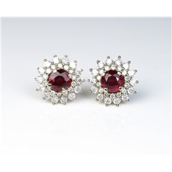 18CAI-15 RUBY EARRINGSExceptional pigeon blood Ruby earrings  featuring two matching round natural N