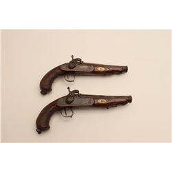 18AR-30 PAIR OF SPANISH PERC.Pair of ornate Spanish officer's style  percussion pistols signed in si