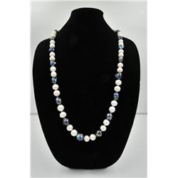18PRS-7 PEARLSOne very fine opera length(36 inches) strand  of black and   white baroque pearls  app