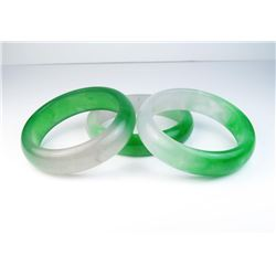 18CAI-56 3 BANGLE BRACELETSLot of three Green and Lavender Jade bangle  bracelets. Estimates $300-$7