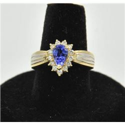 18RPS-23 TANZANITE RINGOne pear shaped tanzanite weighing approx 1ct  set in a 14k yellow gold tradi