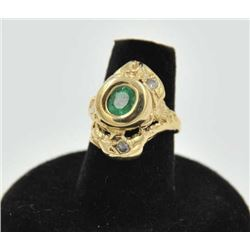 18RPS-25 EMERALD & DIAMOND RINGOne free form floral designed ring set with  an oval emerald and diam