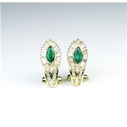 18CAI-27 EMERALD & DIAMOND EARRINGSDazzling earrings with two matching Emeralds  and 64 baguette and