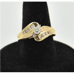 18RPS-37 DIAMOND RINGOne 14k yellow gold bypass  ring set with a  center  diamond weighing 0.20ct pl