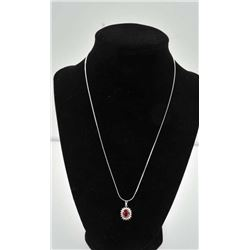 18PRS-3 RUBY & DIAMOND PENDANTOne fine quality ruby diamond 18k white gold  pendant with oval ruby w