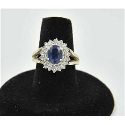 18PRS-10 SAPPHIRE & DIAMOND RINGOne 14k white gold ladies ring set with an  oval sapphire weighing a
