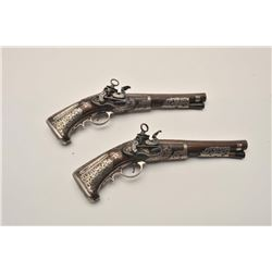 EVE-80 PAIR OF MIQUELET PISTOLSSuperb pair of ornately silver mounted  miquelet pistols in Spanish R
