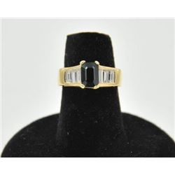 18RPS-16 SAPPHIRE RINGOne ladies ring in 14k yellow gold set with  an emerald cut sapphire approx.2c