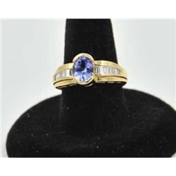 18PRS-17 TANZANITE & DIAMOND RINGOne ladies ring in 14k yellow gold set with a  oval tanzanite appro