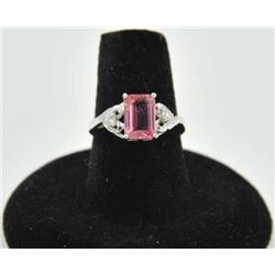 18PRS-11 TOURMALINE & DIAMOND RINGOne emerald cut pink tourmaline  approx 2ct  with 2 side diamonds