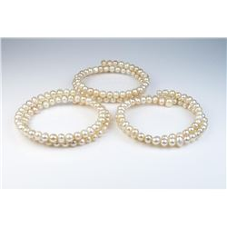 18CAI-62 BANGLE BRACELETNice lot of three Freshwater Pearl bangle  bracelets of a peach cream color