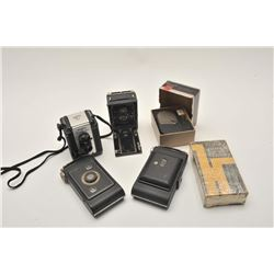 18AL-83 VINTAGE AND ANTIQUE CAMERA LOTBonanza lot of vintage and antique box  cameras, Polaroid, Bro