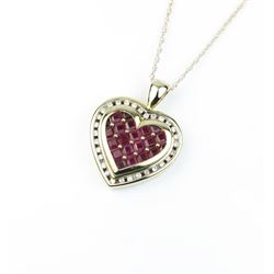 18CAI-46 RUBY PENDANTGorgeous heart shape Ruby pendant signed  'KEEPSAKE' featuring invisible set re
