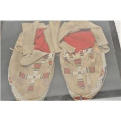 18AP-69 BEADED MOCSPair of Indian beaded moccasins in riker  case; cross designs.      Est.:  $100-$