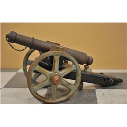 17JL-136 BLACK POWDER CANNONLot of collectibles including an iron signal  cannon on iron carriage wi