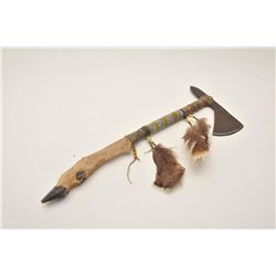 18AP-61 TOMAHAWKTomahawk with beaded shaft and deer foot  bottom portion of grip; approximately 21.5