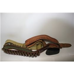 Collection of shell belts and Pachmayr decelerator slip on